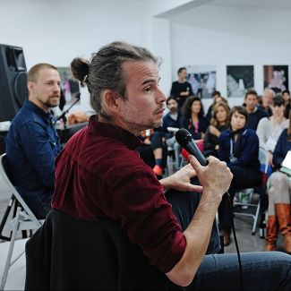 2019: Mathieu Asselin in conversation with Florian Schairer and the audience. Picture: Gina Bolle
